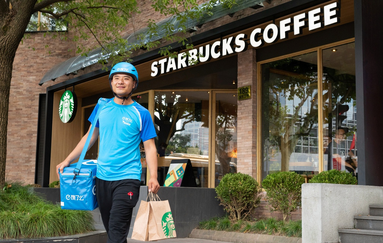 The unprecedented Starbucks partnership will tackle the ambitious goal of coffee delivery
